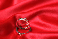 Wedding rings. A pair of wedding rings on a red cloth Stock Photography