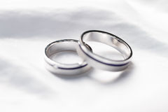 Wedding rings. Two weddings rings on a background a fabric Royalty Free Stock Image