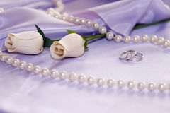Wedding rings. Roses, perls, rings and satin Royalty Free Stock Photo