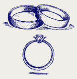 Wedding rings. Doodle style. Vector Stock Images