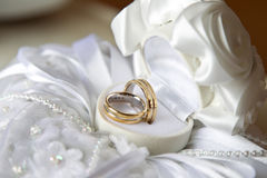 Wedding rings. Two wedding rings on a box made from white silk Royalty Free Stock Photos