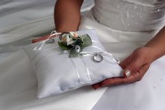 Wedding rings. Bride is holding a wedding rings Stock Image