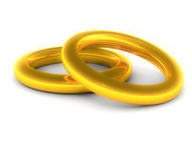 Wedding rings. Engagement or wedding rings in gold, over white background Stock Photos