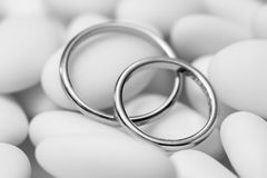 Wedding Rings. Black and White Wedding Rings on candies - Macro Shot Stock Images