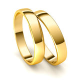 Wedding Rings. Couple of golden wedding rings  on white background Royalty Free Stock Photography