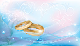 Wedding rings. On pink blue background with ornaments and white lilies Stock Photography