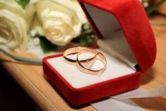 Wedding Rings. In red box on the background of the bride's bouquet stock photography