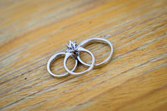 Wedding rings. On the wooden table Royalty Free Stock Photo