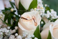 Wedding rings. Wedding accessories, list, wedding, wedding attributes, wedding bouquet, newly-married couple, happiness, pleasure, wedding symbolics, flowers Royalty Free Stock Image