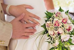 Wedding rings. Wedding background: hands, rings and wedding bouquet royalty free stock images