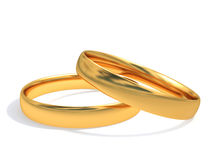 Wedding rings. Gold wedding rings joined together Royalty Free Stock Photos