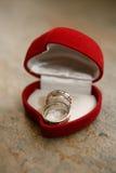 Wedding rings. Weddings rings in a heart-box Stock Photos