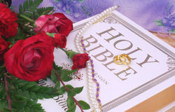 Wedding Rings. Roses With Wedding Rings, necklace and Bible Stock Image