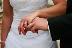 Wedding rings. Bride and groom holding hands showing their wedding rings stock photos