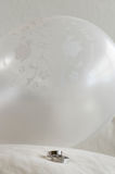 Wedding rings. On pillow.  Party balloon on background Stock Photos