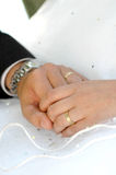 Wedding Rings. Photo of wedding rings and two hands stock image