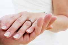 Wedding rings. Couple holding hands with wedding rings (just married Stock Photos