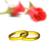 Wedding rings. Golden wedding ring with clipping path on rose background (out of focus Stock Images