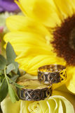 Wedding Rings. On yellow sunflower focus on bands Royalty Free Stock Photography