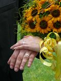 Wedding rings. Two wedding rings and one betrothal ring and wedding bouquet Stock Photo