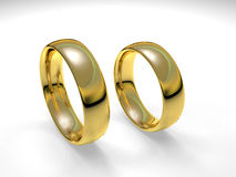 Wedding Rings. Pair of Gold wedding rings rendered in 3D isolated in white background Royalty Free Stock Photos
