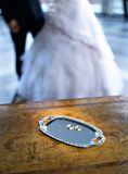 Wedding rings. Two wedding rings with newly married couple at background stock photos