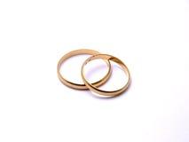Wedding rings. Golden wedding rings on white background royalty free stock photos