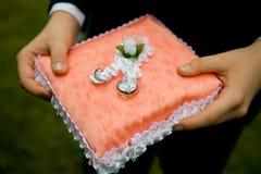 Wedding rings. The ring bearer holds the ring bearer's pillow Stock Photo