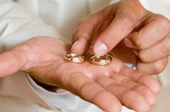 Wedding rings. The man holds two beautiful wedding rings on a hand Royalty Free Stock Image