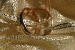 Wedding rings. On gold brocade Stock Images