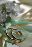Wedding rings. Two wedding rings with satiny tapes Stock Image