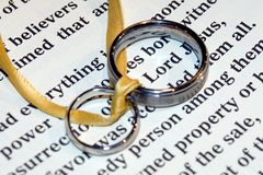 Wedding rings. On Bible stock photo