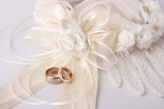 Wedding rings. With the wreath and gloves as a background Royalty Free Stock Photography