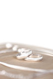 Wedding Rings. On the silk against white background royalty free stock image