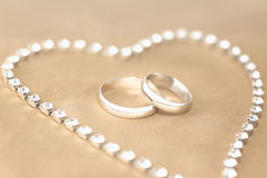 Wedding Rings. Surrounded by heart shape stock image