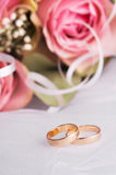 Wedding rings. With flowers and pearls Royalty Free Stock Image