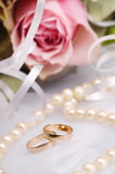 Wedding rings. With flowers and pearls Stock Photography
