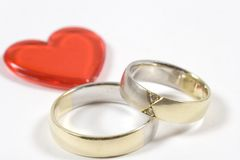 Wedding rings. Two wedding rings and one heart Royalty Free Stock Photos