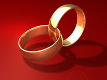 Wedding rings. Two golden rings on red background Royalty Free Stock Image