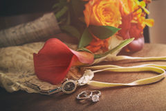 Wedding rings and accessories on chair Royalty Free Stock Images