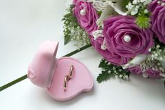 Wedding Rings And Bouquet Of The Bride Stock Photography