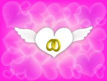 Wedding Rings in Angle Hearth on Pink Background Royalty Free Stock Photos