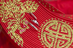 Wedding rings on Ao dai hat Royalty Free Stock Photos