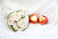 Wedding rings on apples and bouquet Stock Photography