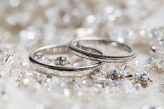 Wedding rings on a background of beads and crystals. Macro Stock Image