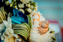 Wedding rings on a background of a bouquet Royalty Free Stock Image