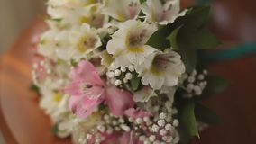 Wedding rings on a background of a bouquet of the bride. Wedding rings on background of a bouquet of the bride stock footage