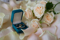 Wedding rings on the background of flowers Stock Photo