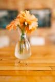 Wedding rings on a background of gerbera flower vases. Wedding j Royalty Free Stock Photos
