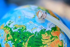 Wedding rings on a background of the globe, world map Stock Photos